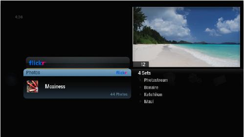 Screenshot of alpha media player, Flickr option selected, and a User is selected. To the right of the User appears a list of the User's Sets.