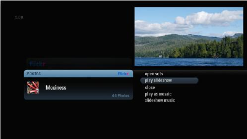 Screenshot of alpha media player. Photo set is selected. A list of options appears on the left, Play Slideshow is highlighted.